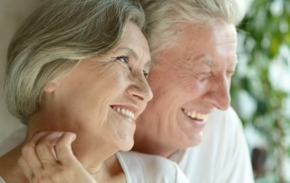 Older couple laughing while looking outside