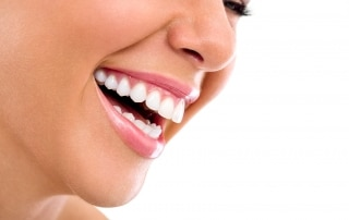 Close up sideview of a woman's beautiful smile