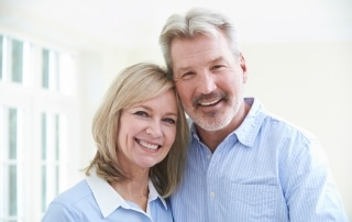 Portrait Of Loving Mature Couple At Home