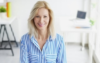 Businesswoman in the office. Portrait of a smiling blond busines
