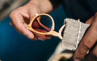 Stylish wooden sunglasses in bag