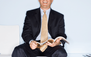 Businessman reading with new Smile