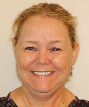 Martha's smiling portrait after dental treatment