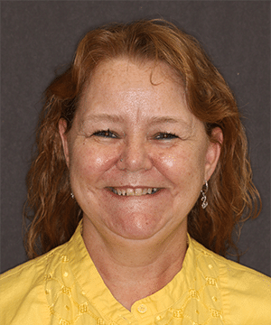 Martha's smiling portrait before dental treatment