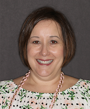 Pam's smiling portrait after dental treatment