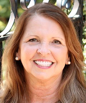 Renee's smiling portrait after dental treatment