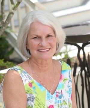 Delores' smiling portrait after dental treatment