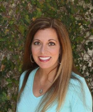 Julie's smiling portrait after dental treatment