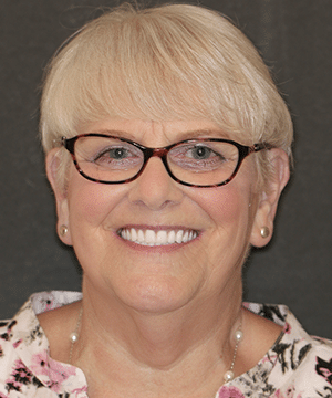 Jan's smiling portrait after dental treatment