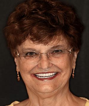 Karen's smiling portrait after dental treatment