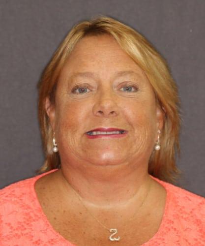 Patrice's smiling portrait after dental treatment