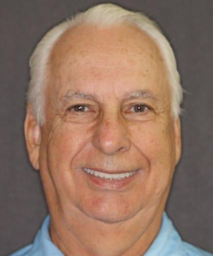 Robert's smiling portrait after dental treatment