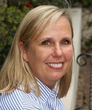 Courtney's smiling portrait after dental treatment
