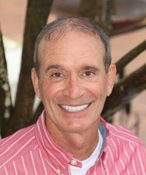 Daniel's smiling portrait after dental treatment