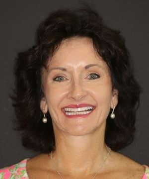 Pat's smiling portrait after dental treatment