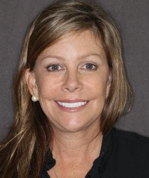 Robin's smiling portrait after dental treatment
