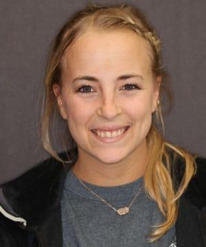 Brittney's smiling portrait before dental treatment