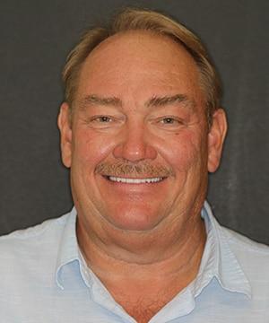 Kenny's smiling portrait after dental treatment