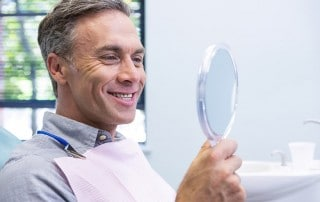 An attractive middleaged man with a white smile with no metal fillings.
