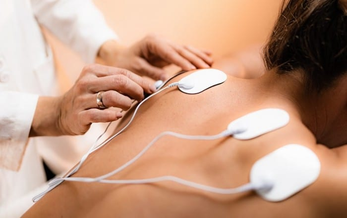 Upper Back Physical Therapy with TENS Electrode Pads, Transcutaneous Electrical Nerve Stimulation. According to the release, KORT therapists use a variety of manual physical techniques, including joint mobilizations, spine and soft tissue massage and trigger point dry needling in an attempt to improve neck mobility, muscle strength and joint balance.