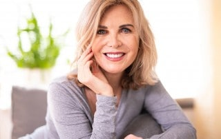 Attractive older woman shows off her new haircut. If you are unhappy with the appearance of wrinkles, the loss of definition around your chin, and other signs of facial aging, one of the first things to try is a new haircut. Here are some styles that can help you look years younger.