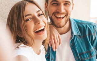 Couple laughing with beautiful smiles
