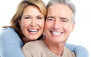 happy senior couple hug one another